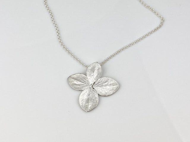"Large 4-petal hydrangea necklace in sterling silver with a bright finish.  On an 18"" sterling silver chain."
