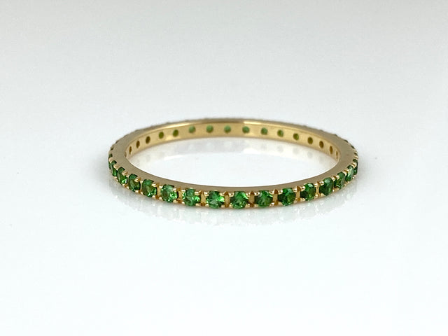 18k yellow gold eternity band with 0.36ctw tsavorite garnets.