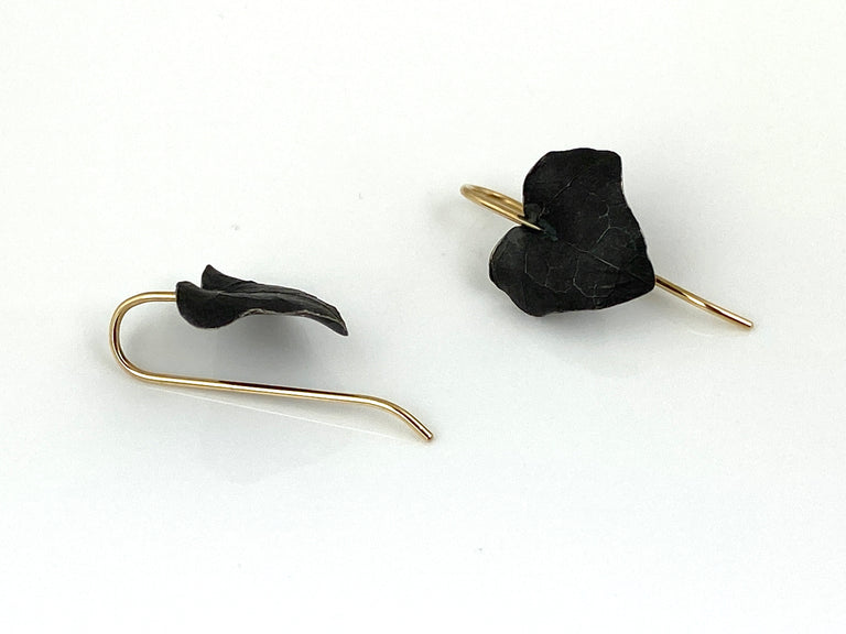 Ivy Leaf drop earrings in sterling silver with a black finish and 14k yellow gold ear wires.