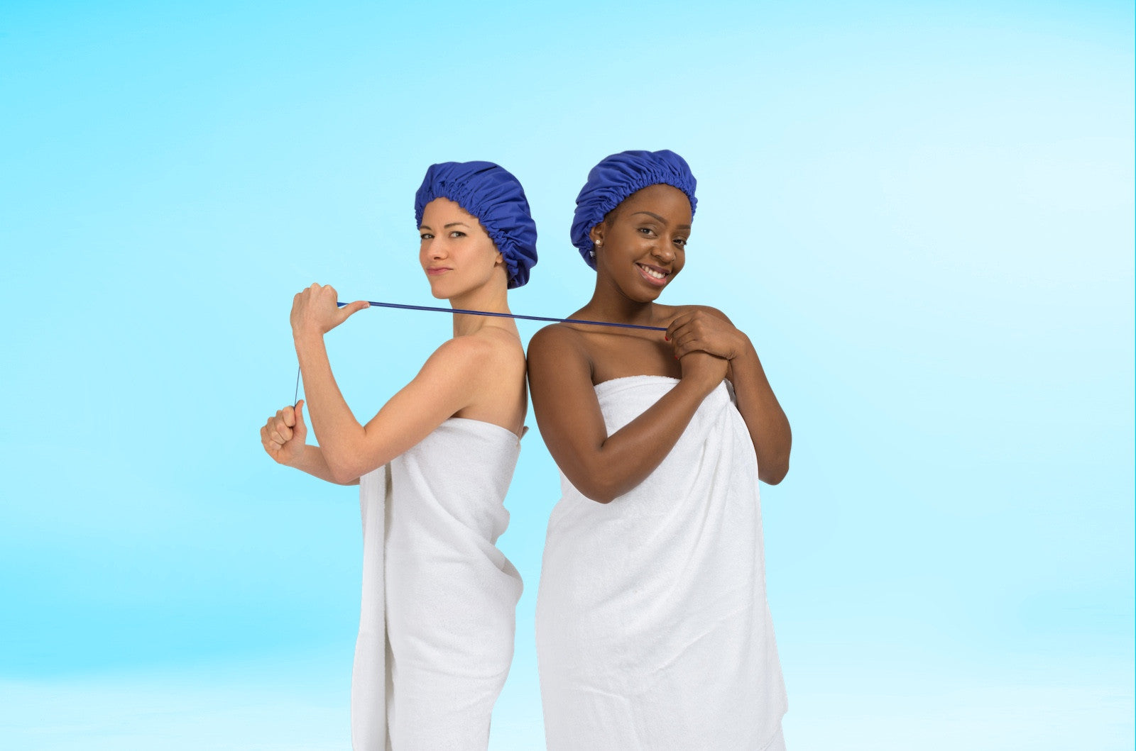 Models wear extra large shower cap made in USA of waterproof breathable fabric (not plastic), with adjustable strap: SUPERPOWER CAP