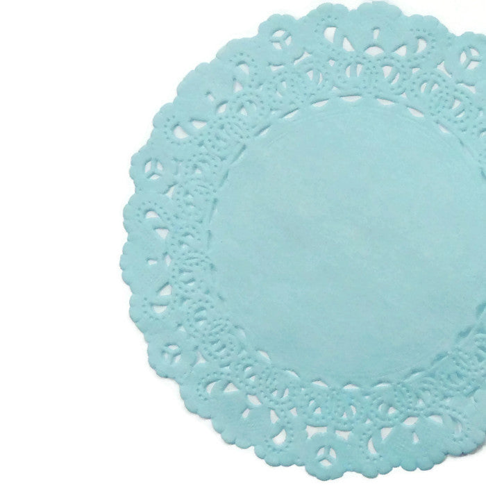 "Baby blue color paper doilies available in the Normandy style and in sizes ranging from 4"" to 16"""