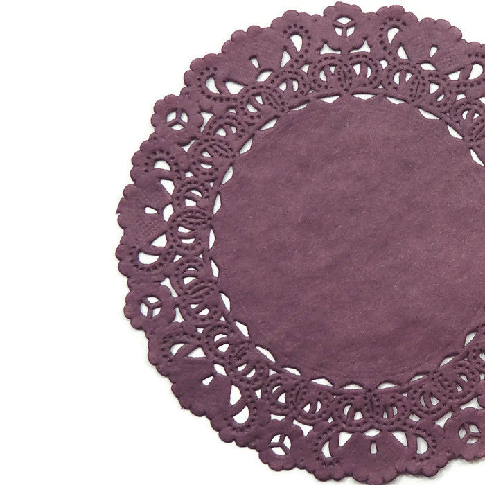"Lacy, Berry Burgundy color paper doilies available in the Normandy style and in sizes ranging from 4"" to 16""."