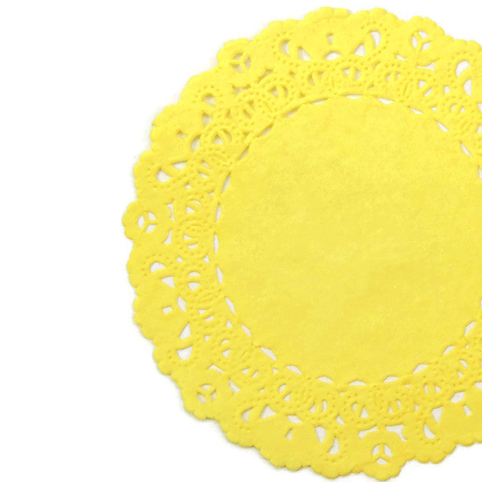 "Tulip Yellow color doilies in 4"" to 16"" sizes"