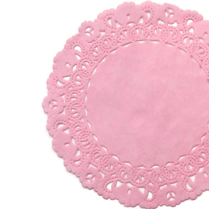 "Lacy, bubble gum pink color paper doilies available in the Normandy style and in sizes ranging from 4"" to 16""."