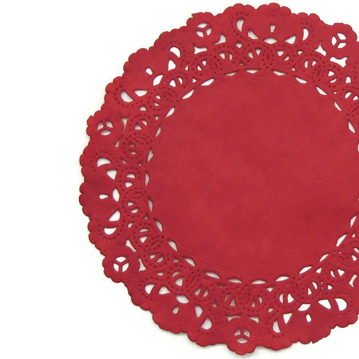 "Cardinal Red color paper doilies available in the Normandy style and in sizes ranging from 4"" to 16""."