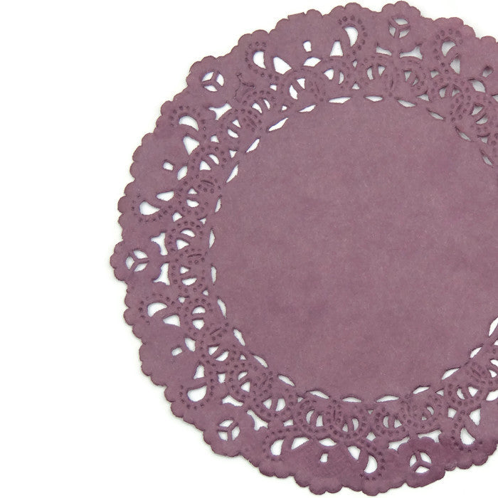 "Lacy, Vintage Mauve color paper doilies available in the Normandy style and in sizes ranging from 4"" to 16""."