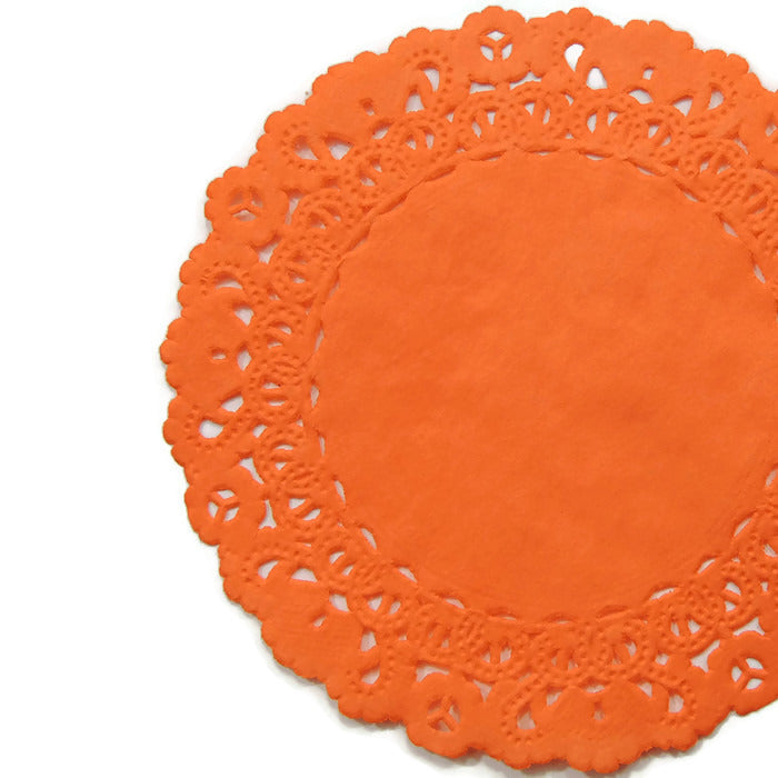 "Dark orange color paper doilies available in the Normandy style and in sizes ranging from 4"" to 16"""