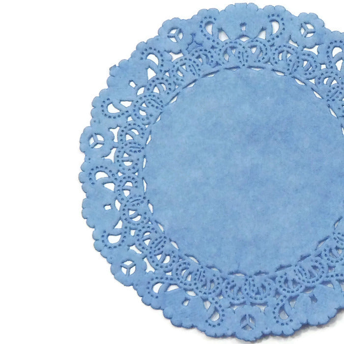 "French blue color paper doilies available in the Normandy style and in sizes ranging from 4"" to 16""."