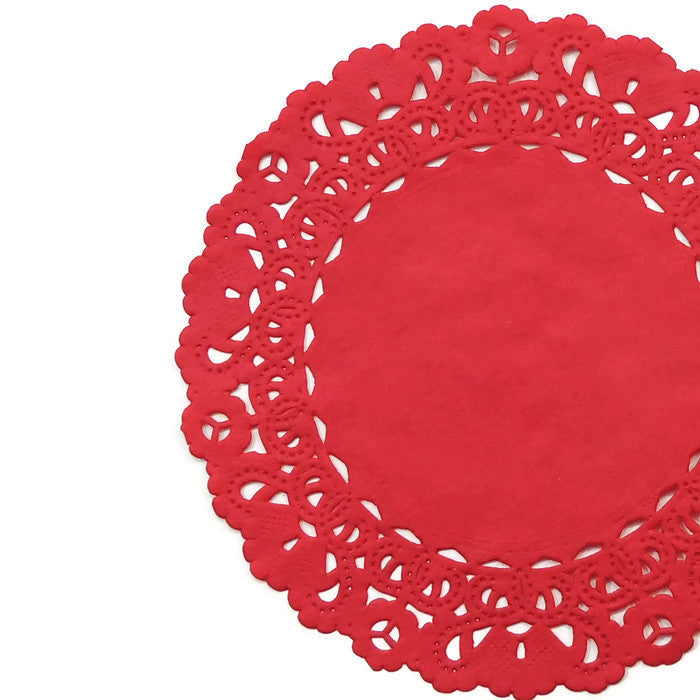 "Red color paper doilies available in the Normandy style and in sizes ranging from 4"" to 16""."