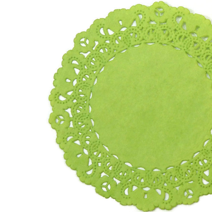 "Light fern green color paper doilies available in the Normandy style and in sizes ranging from 4"" to 16""."
