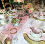 "Lovely wedding shower tablescape using 12"" gold paper doilies"