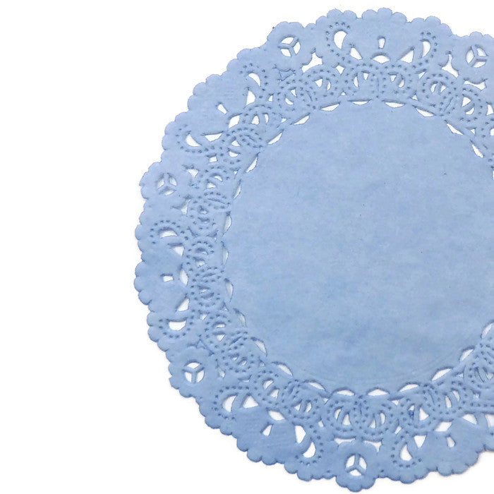 "Ice blue color paper doilies available in the Normandy style and in sizes ranging from 4"" to 16""."
