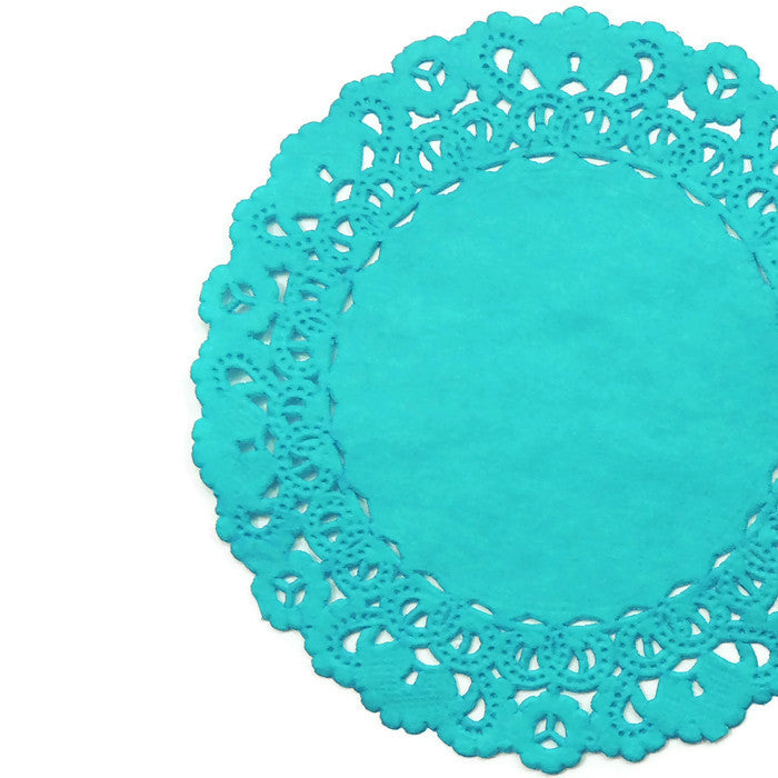 "Peacock blue color doilies available in 4"" to 16"" round sizes."