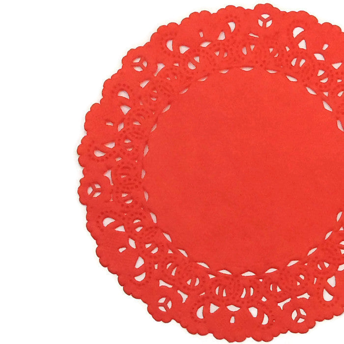 "Rouge Red color paper doilies available in the Normandy style and in sizes ranging from 4"" to 16""."