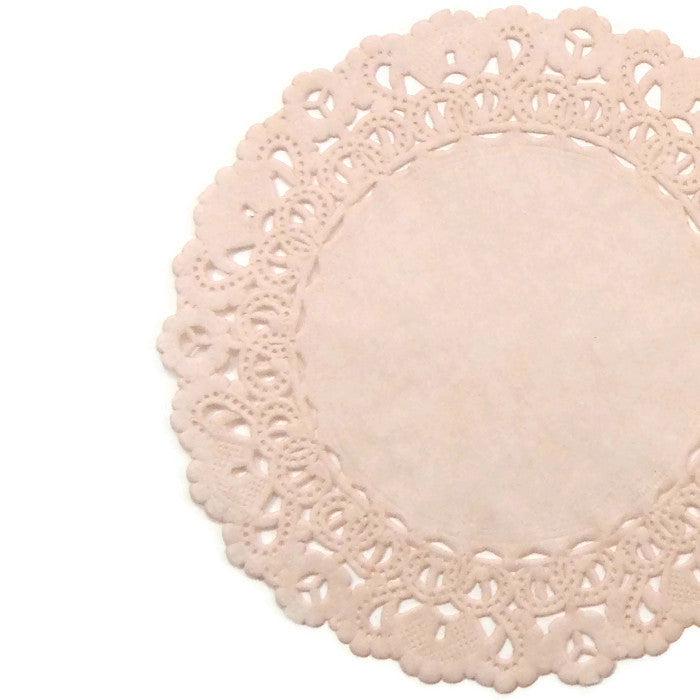 "Nude color paper doilies available in the Normandy style and in sizes ranging from 4"" to 16""."