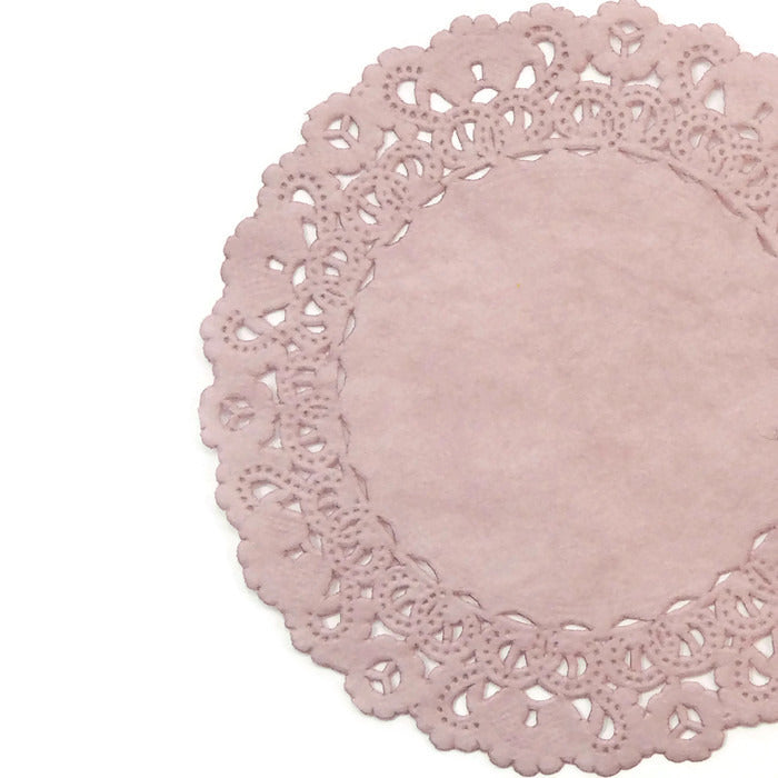 "Lacy, Dusty Rose Mauve color paper doilies available in the Normandy style and in sizes ranging from 4"" to 16""."
