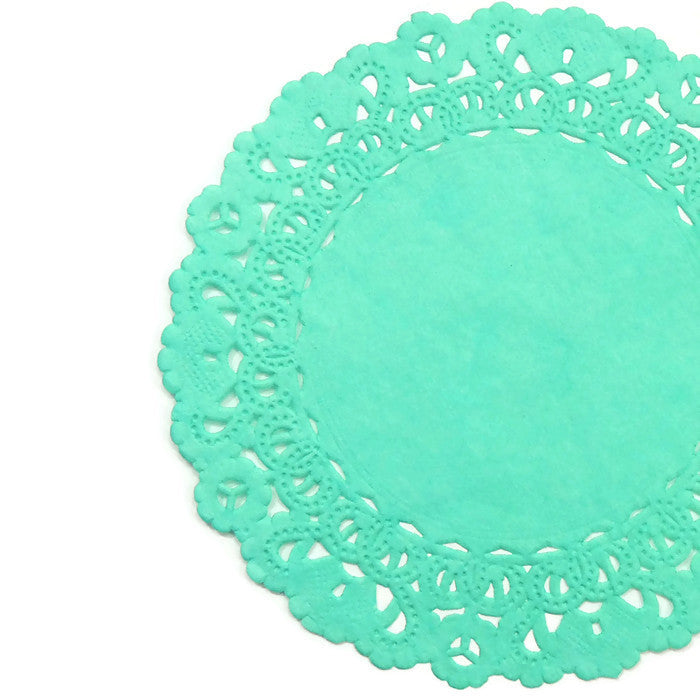 "Spa Green color paper doilies available in the Normandy style and in sizes ranging from 4"" to 16""."