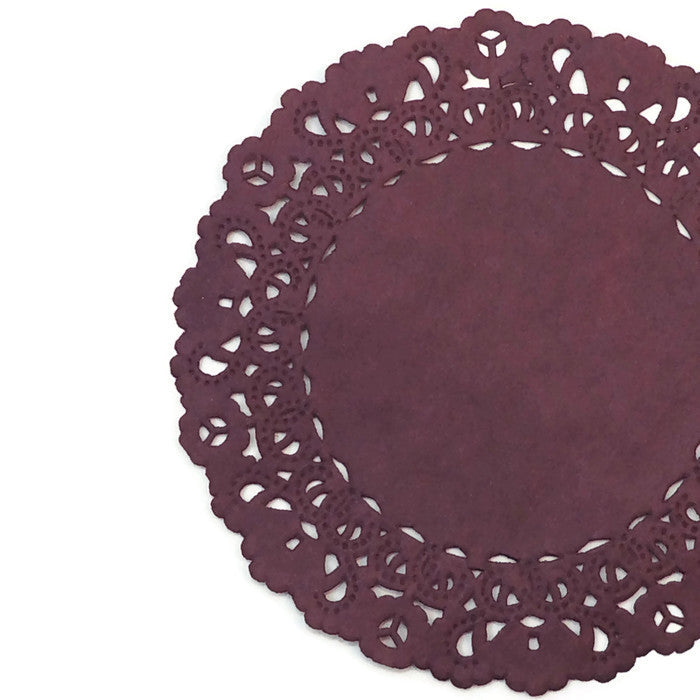 "Dark Currant color paper doilies available in the Normandy style and in sizes ranging from 4"" to 16""."
