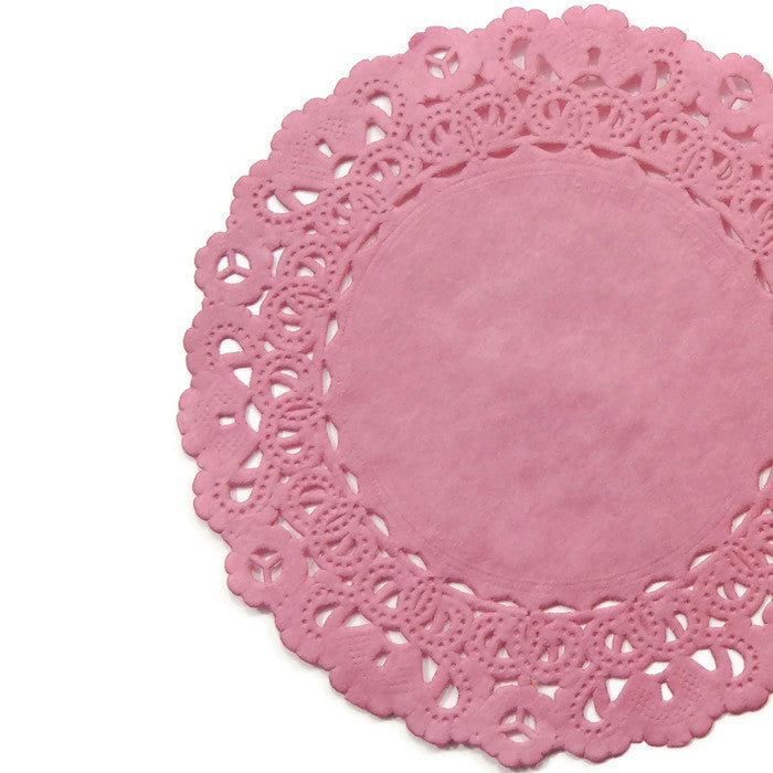 "Lacy, Cottage Rose Pink color paper doilies available in the Normandy style and in sizes ranging from 4"" to 16""."