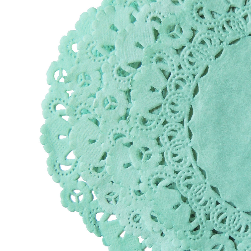 "Seaglass color paper doilies available in the Normandy style and in sizes ranging from 4"" to 16""."