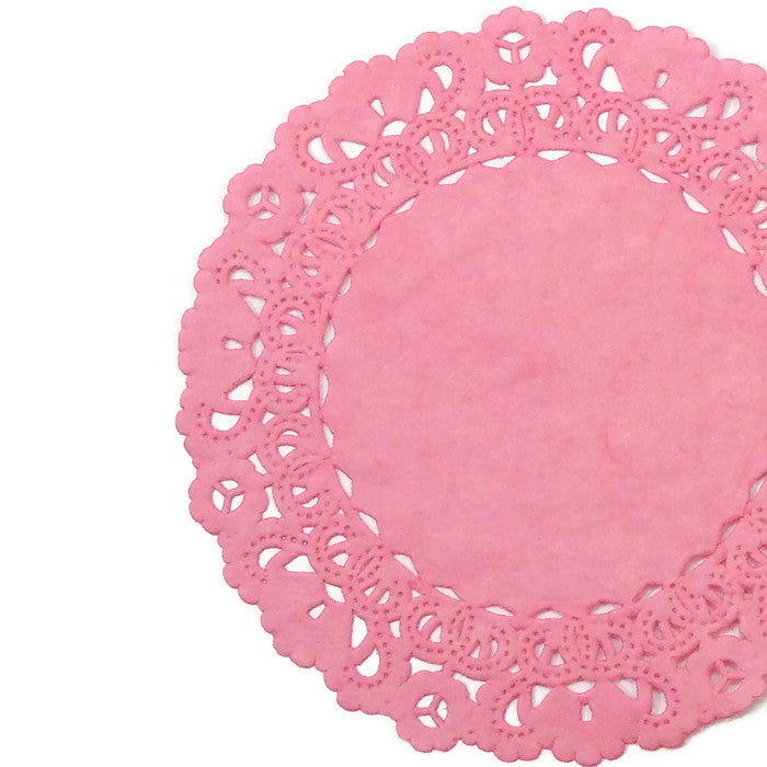 "Strawberry Pink color paper doilies available in the Normandy style and in sizes ranging from 4"" to 16""."