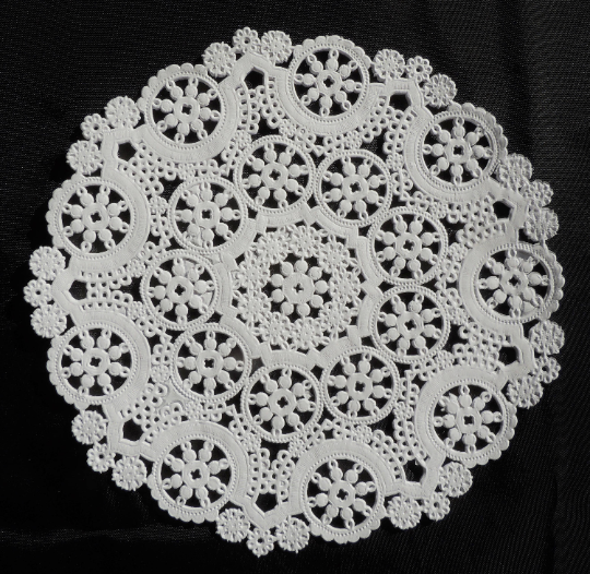 "White Medallion Paper Doily in sizes from 4"" to 12""."