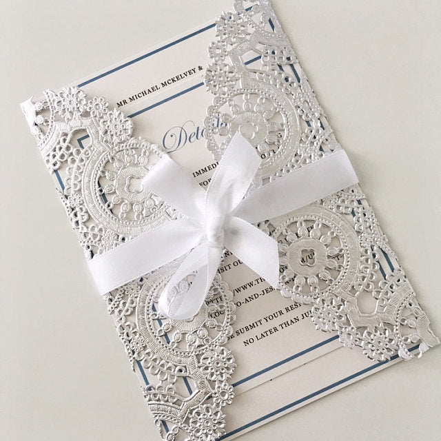 "10"" silver medallion doily used on a 5x7 invitation card"