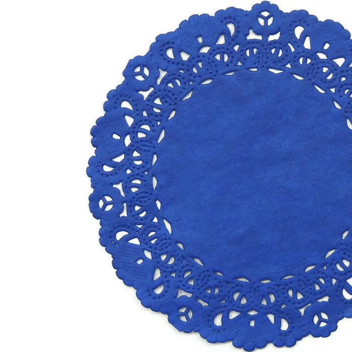 "Sapphire blue color paper doilies available in the Normandy style and in sizes ranging from 4"" to 16""."