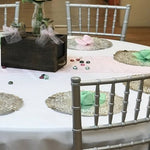"Beautiful and inexpensive chargers using 12"" silver doilies"