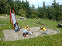children playing in sandpit whilst camping