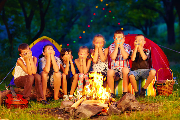 Kids Camping by a Campfire After Dark