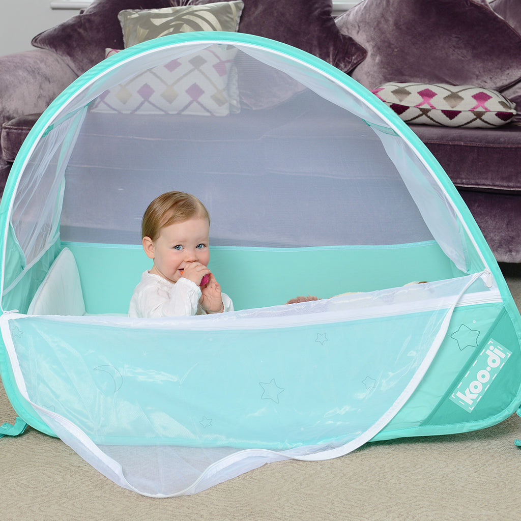 Baby in Pop-Up Travel Bubble Cot for camping babies, at Kids Camping Store