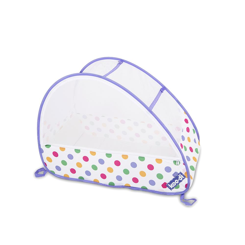 Children's pop-up travel cot in pastel polka dots, from Kids Camping Store, viewed at an angle