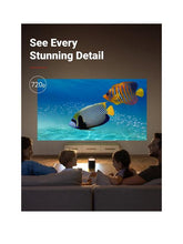 Load image into Gallery viewer, Anker Nebula Mars 2 II Pro Projector for camping, sleepovers and parties, projecting onto a lounge wall