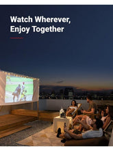 Load image into Gallery viewer, Anker Nebula Mars 2 II Pro Projector for camping, sleepovers and parties, projecting onto a white screen on a rooftop terrace