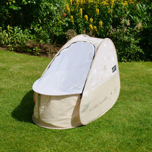 Load image into Gallery viewer, Pop Up Travel Cot with blackout cover, shown on grass