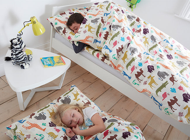 Kids asleep in Dinky Duvalay, Childrens Luxury Camping Bed, at Kids Camping Store
