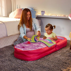 Pregnant mum sat next to girl in MyFirst ReadyBed with purple horses design