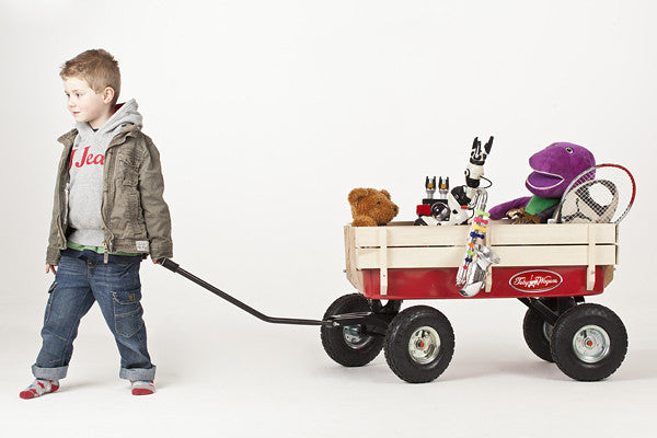 Child pulling Retro Toby Wagon (Festival Trolley) for Children at camping festivals and events