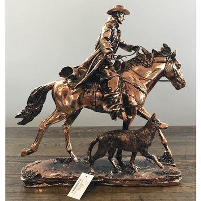 Copper Stockman On Horseback With His Dog