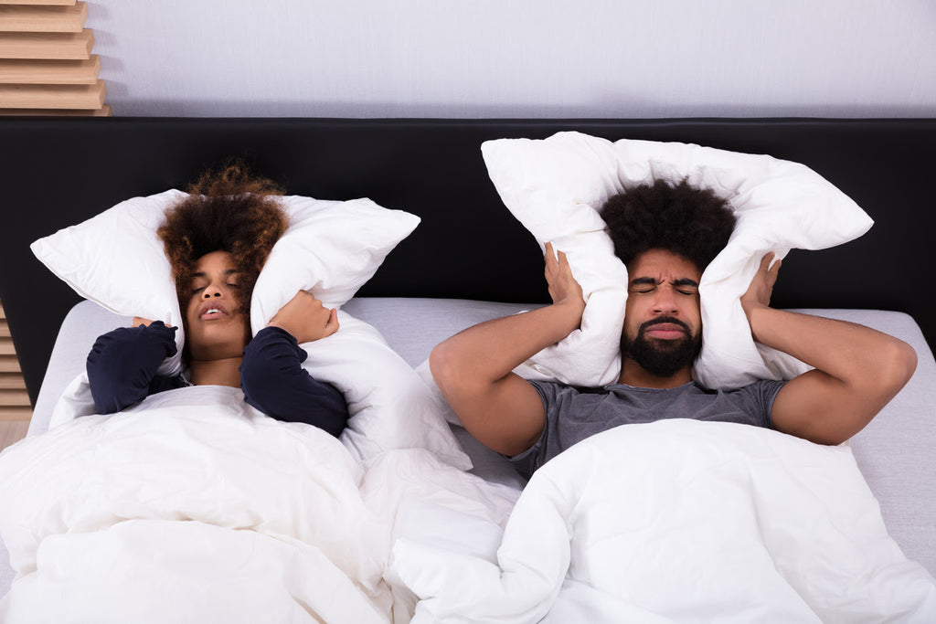 Noise pollution affecting a couple in bed that can't sleep