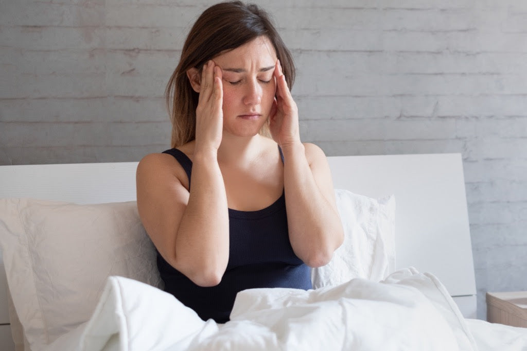 Woman unhappy in bed with lack of sleep symptoms