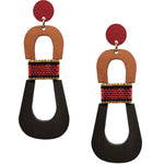 Modern, curvy, red, brown, and dark brown color blocked statement earrings with hand-beaded accents by the brand SCOTCHBONNET.