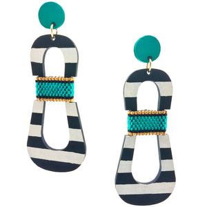 Modern, curvy, black and white striped statement earrings with hand-beaded teal accents by the brand SCOTCHBONNET.