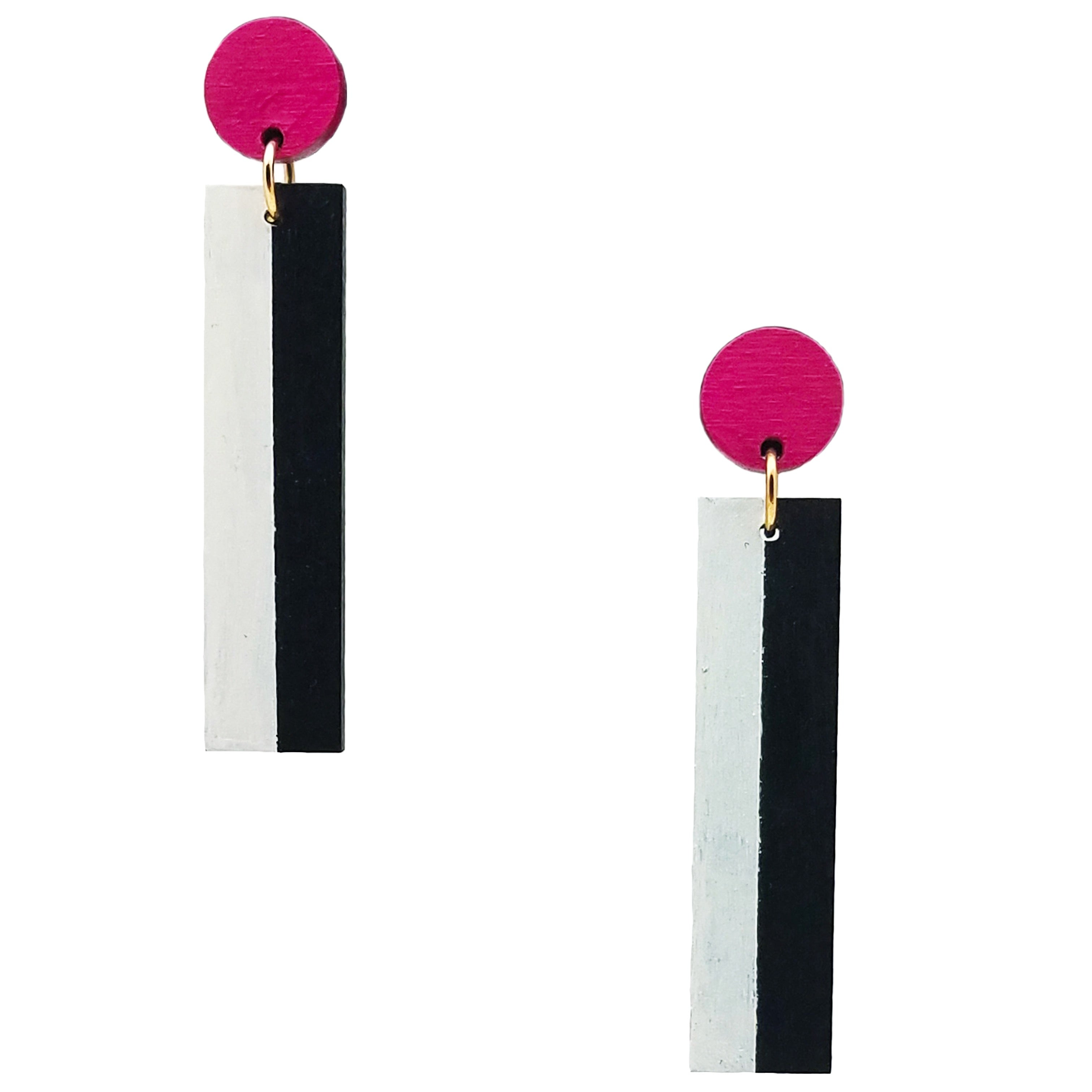 Geometric magenta, white, and black color blocked statement earrings by the brand SCOTCHBONNET.