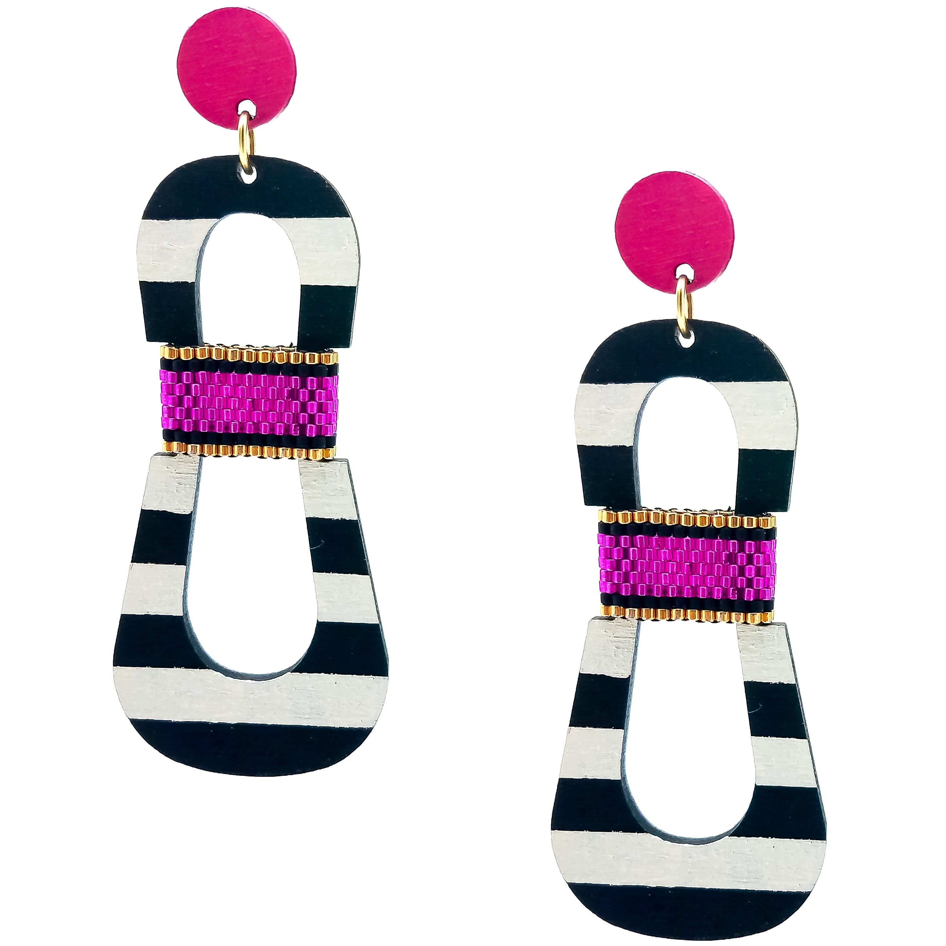 Modern, curvy, black and white striped statement earrings with hand-beaded magenta accents by the brand SCOTCHBONNET.