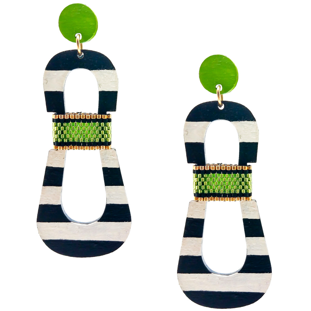 Modern, curvy, black and white striped statement earrings with hand-beaded chartreuse accents by the brand SCOTCHBONNET.