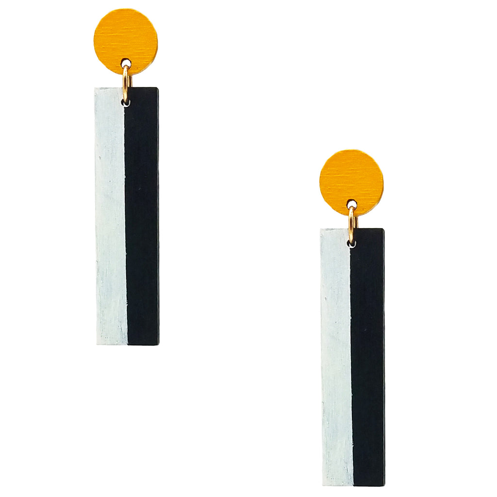 Geometric yellow, white, and black color blocked statement earrings by the brand SCOTCHBONNET.