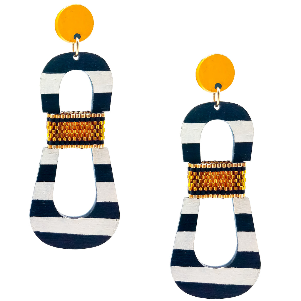 Modern, curvy, black and white striped statement earrings with hand-beaded yellow accents by the brand SCOTCHBONNET.