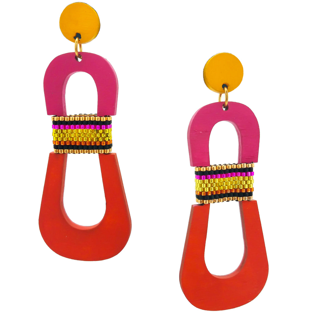 Modern, curvy, yellow, magenta and orange color blocked statement earrings with hand-beaded accents by the brand SCOTCHBONNET.